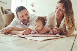 smiling parents with baby