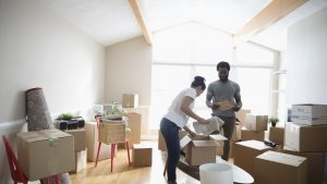 man and woman packing boxes